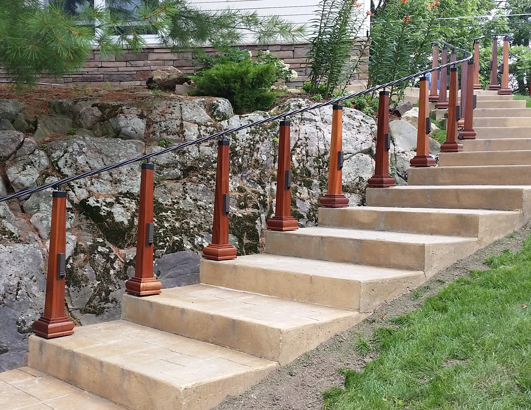 Hand twisted steel railings, Mahogany posts with LED lighting