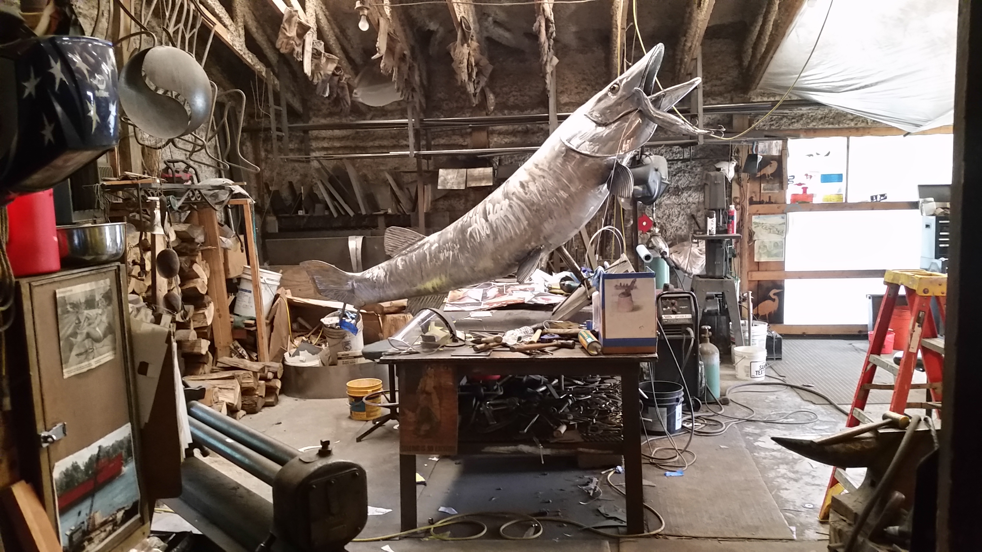 Muskie on welding bench